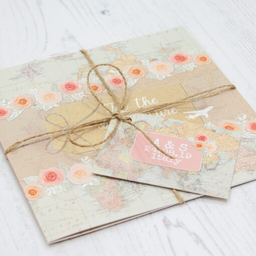 Close up of Folded Adventure Wedding Invitations with String & Tag