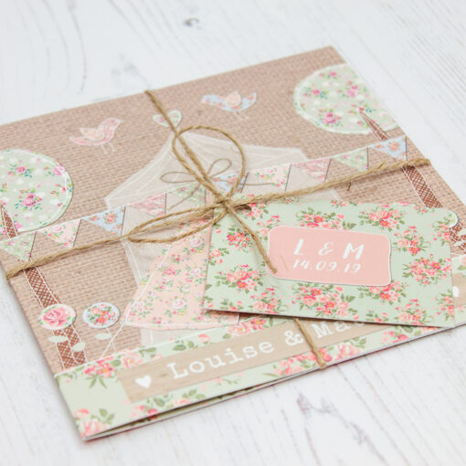 Close up of Folded Country Wedding Invitations with String & Tag