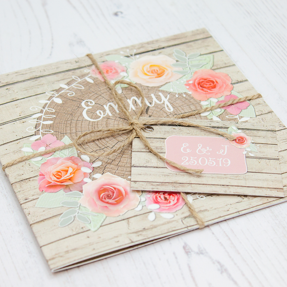 Close up of Folded Flower Crown Wedding Invitations with String & Tag