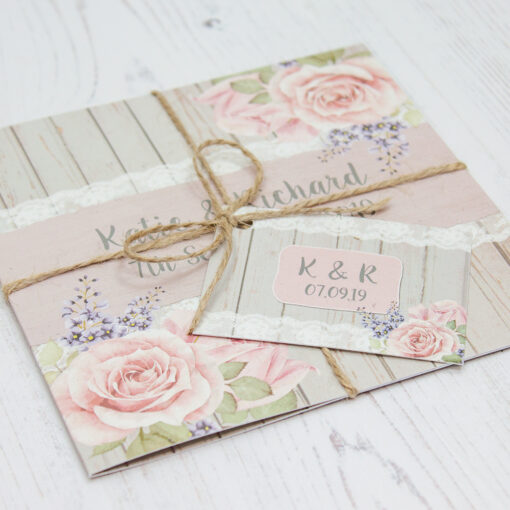Close up of Folded Mink Rose Wedding Invitations with String & Tag