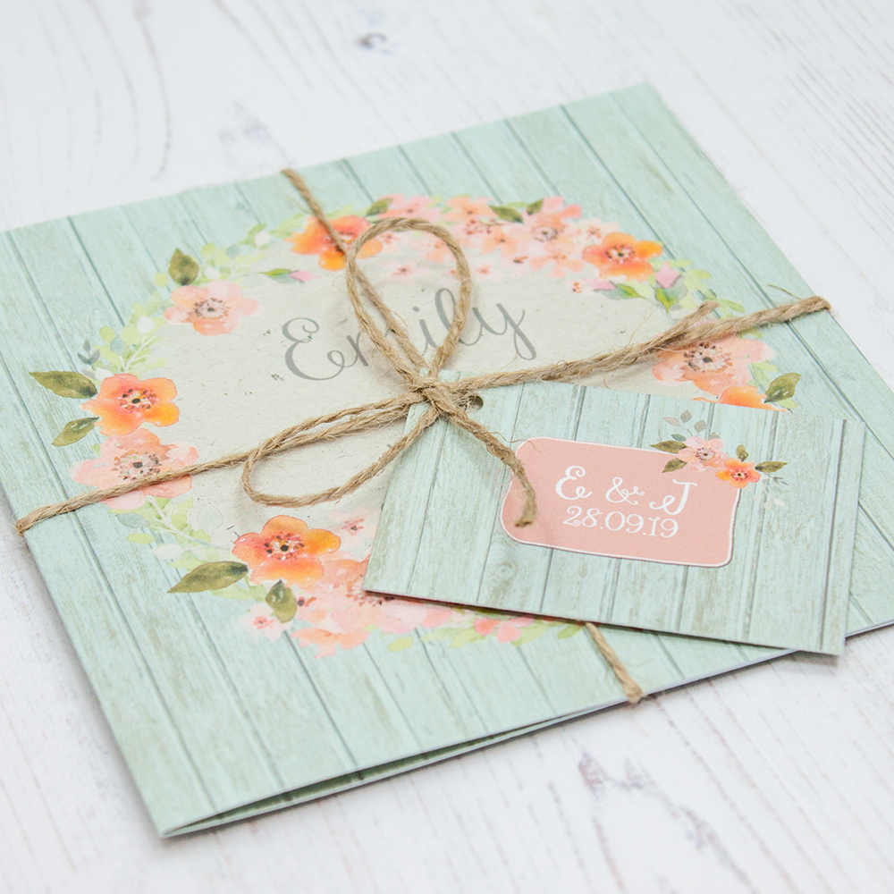 Close up of Folded Prairie Peach Wedding Invitations with String & Tag