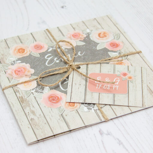 Close up of Folded Rose Cottage Wedding Invitations with String & Tag