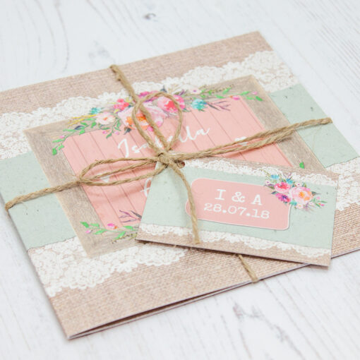Close up of Folded Rustic Farmhouse Wedding Invitations with String & Tag