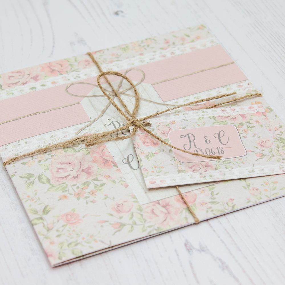 Close up of Folded Summer Breeze Wedding Invitations with String & Tag