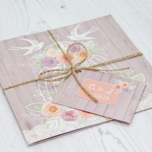 Close up of Folded Vintage Birdcage Wedding Invitations with String & Tag